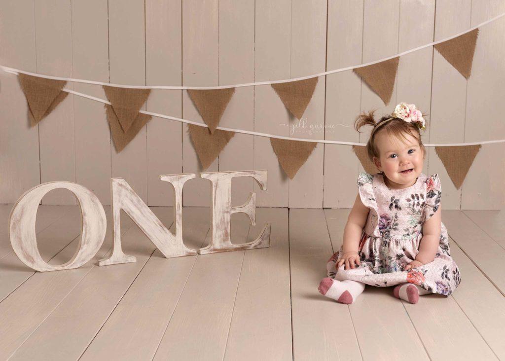 Photograph of Baby girl at first Birthday photoshoot taken at Jill Garvie Photography studio in Edinburgh