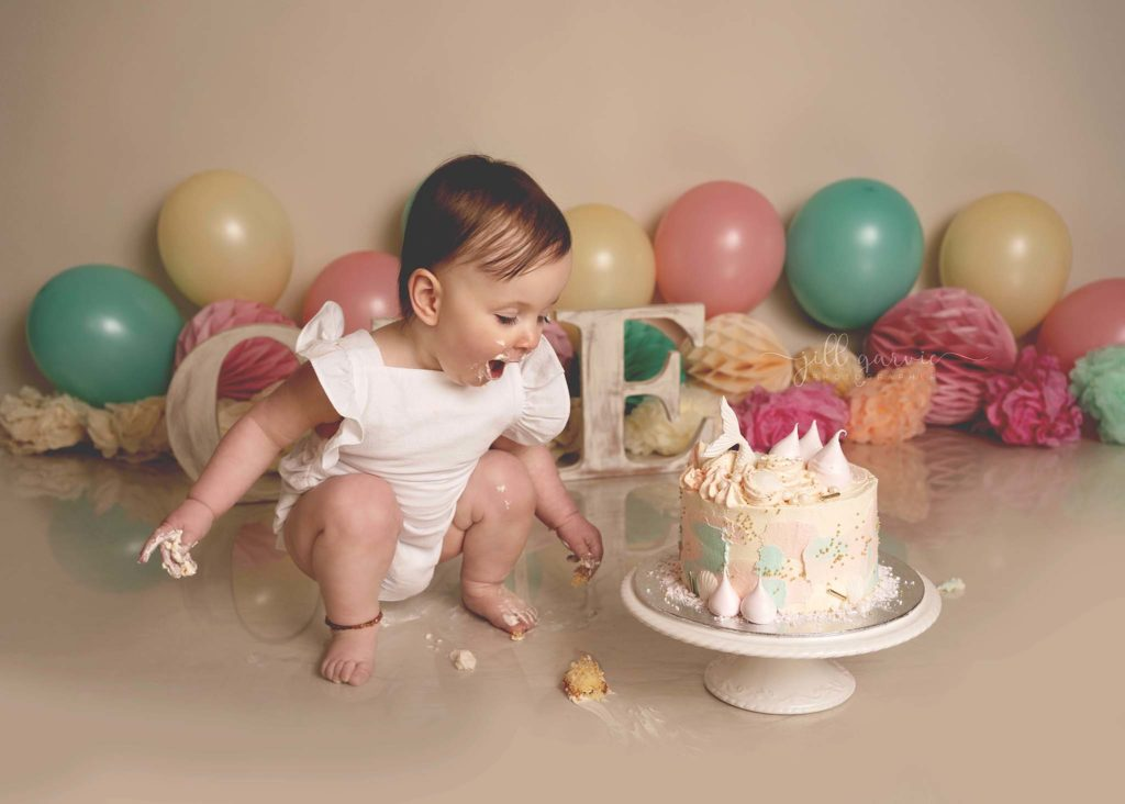 Photograph of Baby girl on first birthday Cake smash photoshoot taken at Jill Garvie Photography Studio in Edinburgh
