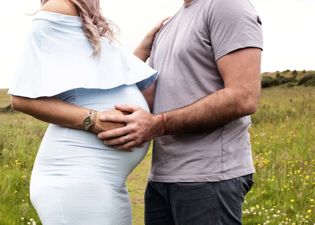 Photograph of Expectant mother and father at Outdoor Maternity session.